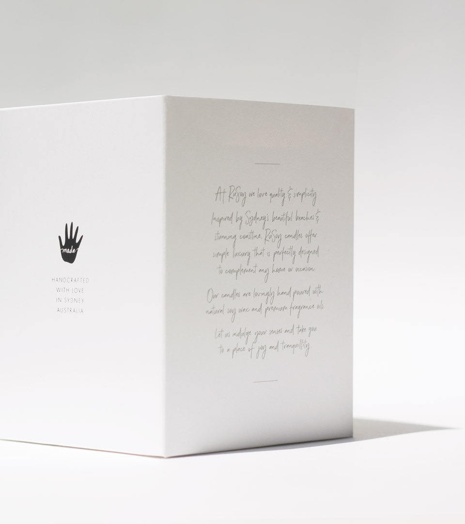 Side and back of pack of the RuSoy candle
